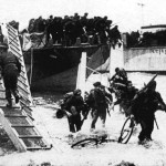 BRITISH_DDAYBSA_in_surf_being_dragged
