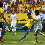 Brazil's Neymar scores a goal during their Confederations Cup Group A soccer match against Japan at Estadio Nacional in Brasilia